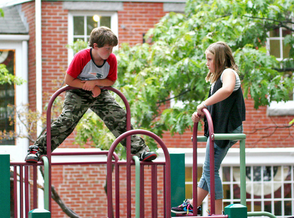 Newburyport: Maddie Duval, 9, and Cian Magauran, 7, hang out on the jungle gym on Inn Street after school Thursday. The pair are students at the Montessori School. Photo by Ben Laing/Staff Photo