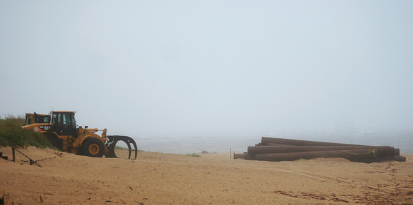Newbury: Equipment on the beach at Plum Island waits to be setup as part of the beach re-nourishment project. Photo by Ben Laing/Staff Photo