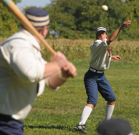 Newbury:  Kristen Rogers of Bristol RI pitches to Essex at the Ipswich Ale Fall Fest Saturday at the Spencer-Peirce Little Farm in Newbury. Along with Vintage Base Ball Games, the event featured crafts, music, beer, a tour of the property and . Jim Vaiknoras/Staff photo