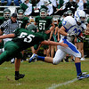West Newbury: Danvers back Matt Irving breaks past Pentucket's Kevin Dunn at Pentucket Saturday. Jim Vaiknoras/Staff photo