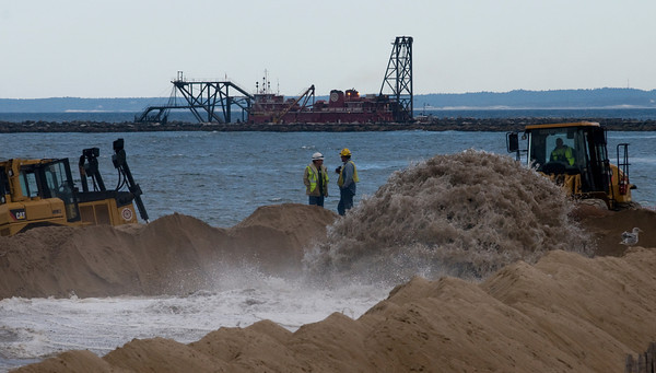 Salisbury: Sand and water from the Merrimack River dredging is pumped onto Salisbury Beach Saturday. Jim Vaiknoras/Staff photo