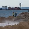Salisbury: Sand and water from the Merrimack River dredging is pumped onto Salisbury Beach Saturday. Jim Vaiknoras/Staff photo