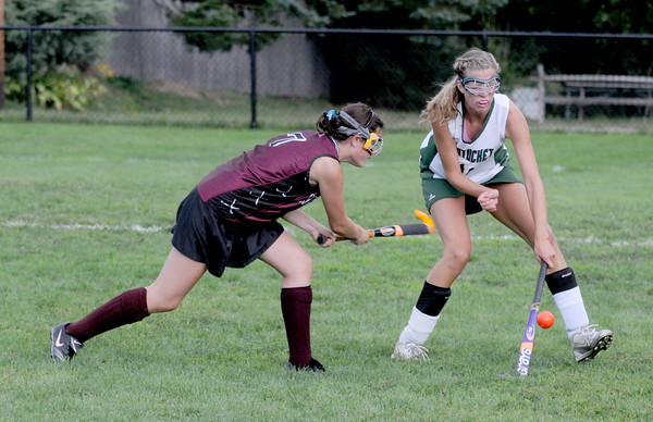 West Newbury: Newburyport's Paige Hefferan hits the ball past Pentucket's Molly McDonough during their game at Pentucket Friday. Jim Vaiknoras/Staff photo