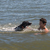 Salisbury: Carolyn Rahn, of Medford, cools off with Stan at Salisbury Beach Monday. Jim Vaiknoras/Staff photo