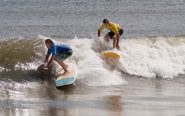 Salisbury: Anthony Hughes and Mike Morin catch a wave at the Labor Day Surf Festival at Salisbury Center Sunday morning. Jim Vaiknoras/Staff photo