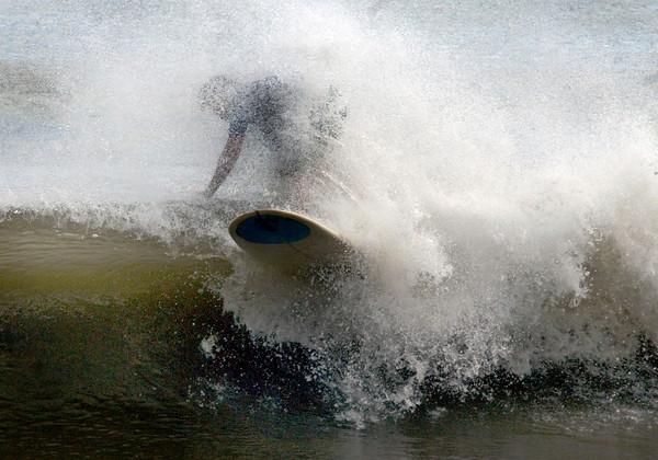 Salisbury: Anthony Hughes rides a wave at the Labor Day Surf Festival at Salisbury Center Sunday morning. Jim Vaiknoras/Staff photo
