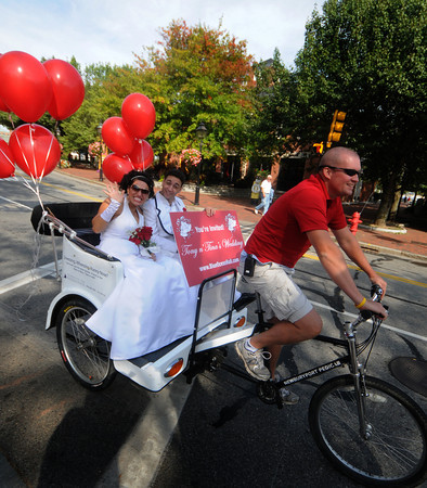 Newburyport: Brian Bates gives a ride to actors Anthony Augello and Concetta Rose Rella on a Pedicab Sunday morning through Market Square in Newburyport. The pair will be staring in Tony n'Tina Wedding at the Blue Ocean Music Hall. Jim Vaiknoras/Staff photo