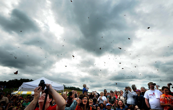 Amesbury: The crowd watches and takes photographs as butterflies are released at the Fly-Away Festival at Woodsom Farm Sunday. The event, which featured several music groups, crafts and pony rides, as well as the release of 1,200 butterflies, benefited Lucy's Love Bus, a nonprofit raising money for children's cancer treatment. Jim Vaiknoras/Staff photo