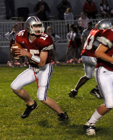 Amesbury: Amesbury's Tyler Lay looks down field for a reciever during the Indians home game against North Andover Friday night. Jim Vaiknoras/Staff photo