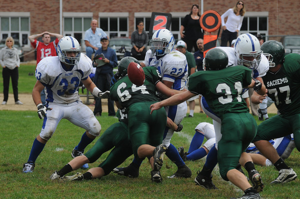 West Newbury:Pentucket#64 Beadon Leach and #22 Dan Cashman combine to cause Danvers' Nick Valles to fumble during their at Pentucket Saturday. Pentucket's Chris Croteau recovered the fumble. Jim Vaiknoras/Staff photo