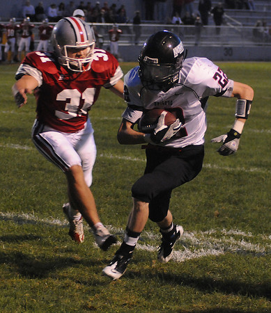 Amesbury: North Andover's David Foote breaks away from Amesbury's Perry Mroz on his way to the endzone during their game at Amesbury Friday night. Jim Vaiknoras/Staff photo