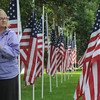 "newburyport: Pat Zalewski of Newburyport fixes a flag at the ""Field of Honor"" at the Bartlet Mall Friday. The rows of flags will serve as a back ground for a 9/11 rememberance this morning at 10am. Jim Vaiknoras/Staff photo"