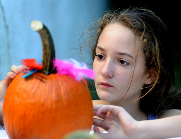 Newbury: Lauren Walker decorates a pumpkin at the Ipswich Ale Fall Fest Saturday at the Spencer-Peirce Little Farm in Newbury. Along with pumpkin decorating, the event featured a Vintage Base Ball Games, music, beer, a tour of the property and . Jim Vaiknoras/Staff photo
