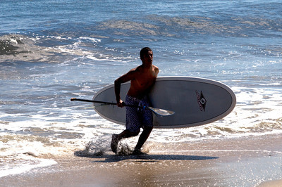 Salisbury: Jared Veltsos come out of the water after the stand up paddling competition at the Labor Day Surf Festival at Salisbury Center Sunday morning. Jim Vaiknoras/Staff photo