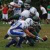 West Newbury: Danvers' Stephen St. Pierre and Pentucket's Matt Berry scramble for a Pentucket fumble during their game at Pentucket Saturday. The ball was recovered by St Pierre. Jim Vaiknoras/Staff photo
