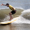 Salisbury: Mike Morin competes in the long board contest at the Labor Day Surf Festival and the big competition at Salisbury Center Sunday morning. Jim Vaiknoras/Staff photo