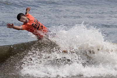Salisbury: Jared Veltsos wipes out  in the long board contest at the Labor Day Surf Festival and the big competition at Salisbury Center Sunday morning. Jim Vaiknoras/Staff photo