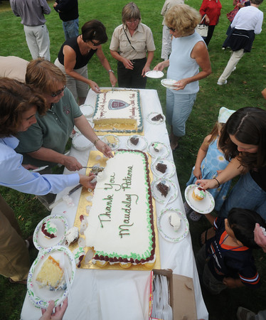 Newburyport: Visitors and park workers enjoy 2 cakes celebrating the 25th anniversary of Maudslay State Park Sunday. Jim Vaiknoras/Staff photo