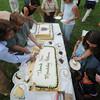 Newburyport: Visitors and park workers enjoy 2 cakes celebrating the 25th anniversary of Maudslay State Park Sunday. Jim Vaiknoras/Staff photo