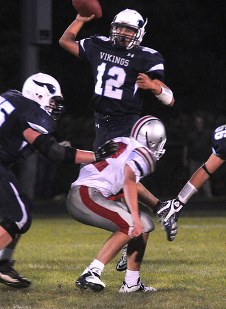 Byfield: Triton quarterback Blaise Whitman loks down the field for a reciever  during the Vikings home game against Amesbury Friday night. Jim Vaiknoras/Staff photo