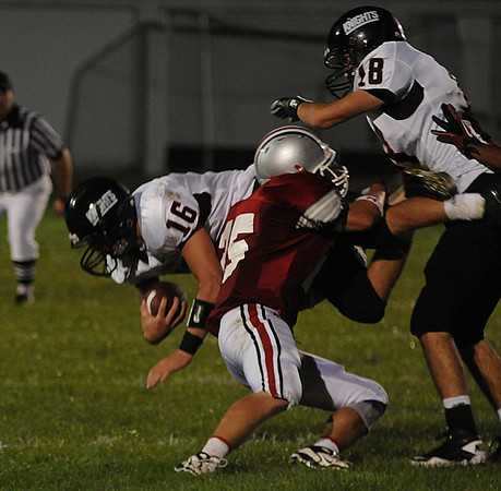 Amesbury: North Andover's Brandon Walsh is tackled by Amesbury's Matthew Enaire during their game at Amesbury Friday night. Jim Vaiknoras/Staff photo