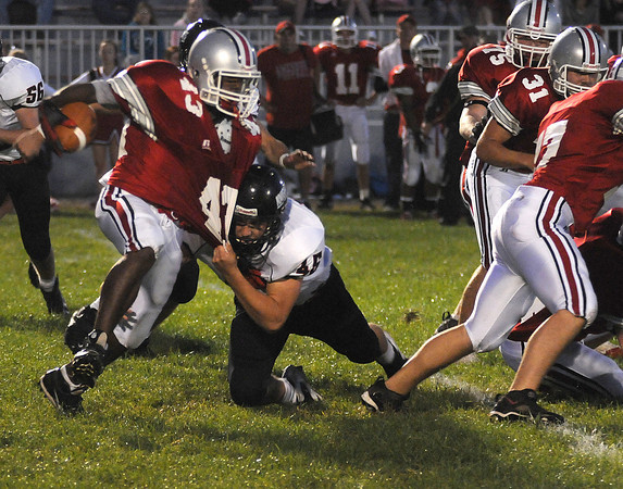 Amesbury: Amesbury's Dalante Castle is pulled down by a Scarlet Knight during the Indians home game against North Andover Friday night. Jim Vaiknoras/Staff photo