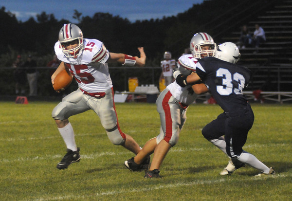 Byfield: Amesbury's Matt Regis springs teammate Tyler Lay for a touchdown during the Indian's game at Triton Friday night. Jim Vaiknoras/Staff photo
