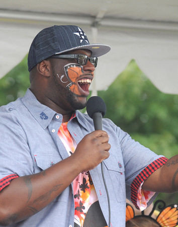 Amesbury: Ahmir performs at the Fly-Away Festival at Woodsom Farm Sunday. The event, which featured several music groups, crafts, pony rides and the release of 1,200 butterflies, benefited Lucy's Love Bus, a nonprofit raising money for children's cancer treatment. Jim Vaiknoras/Staff photo