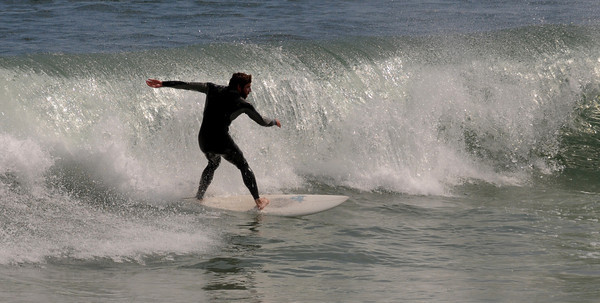 Salisbury: A surfer rides a wave on Salisbury Beach Saturday morning. Jim Vaiknoras/Staff photo