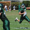 West Newbury: Pentucket's Mike Doud looks for yardage against Marblehead at home Saturday. Jim Vaiknoras/Staff photo