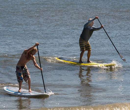 Salisbury: Lars jacobson and Buddy Stevenson race to the finish in the stand up paddling contest at the Labor Day Surf Festival at Salisbury Center Sunday morning. Jim Vaiknoras/Staff photo