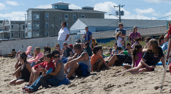 Salisbury: Spectators enjoy the sun, sand and surfing at the Labor Day Surf Festival at Salisbury Center Sunday morning. Jim Vaiknoras/Staff photo