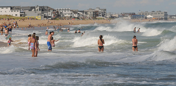 Salisbury: People play in the high surf caused by the remnants of Hurricane Earl Saturday afternoon at Salisbury Beach Reservation. Jim Vaiknoras/Staff photo