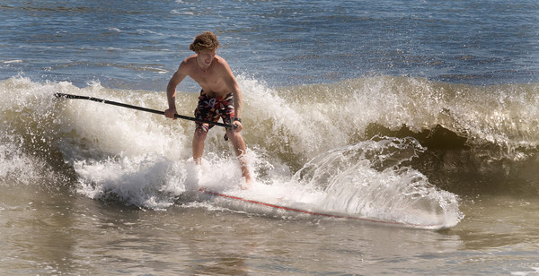 Salisbury: Kyle Linesman wins the stand up paddling competition at the Labor Day Surf Festival at Salisbury Center Sunday morning. Jim Vaiknoras/Staff photo