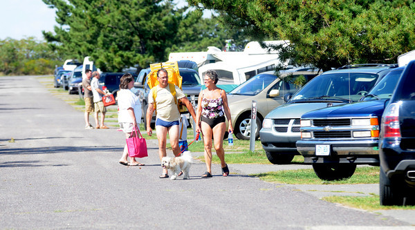 Salisbury: Camper returned to of Salisbury Beach Reservation Saturday afternoon after the the grounds were closed due to Hurricane Earl. Jim Vaiknoras/Staff photo