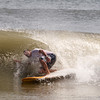 Salisbury: Jeff Pilibosian of Portsmouth in the long board contest at the Labor Day Surf Festival and the big competition at Salisbury Center Sunday morning. Jim Vaiknoras/Staff photo