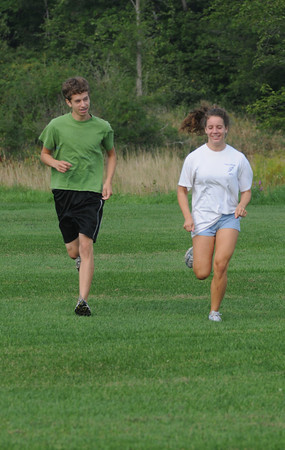 Byfield: Sara and Sam Auwerda members of the Triton track team warm up before practice at the school. Jim Vaiknoras/Staff photo