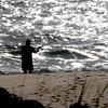 Nebury: A fisherman cast his line in the early morning light on Plum Island. Jim Vaiknoras/Staff photo