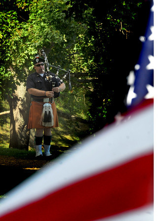 Newburyport: Newburyport firefighter Jim Gabriel plays the pipes  on the Bartlet Mall at  a ceremony marking the 9th anniversary of the September 11 attacks. Jim Vaiknoras/Staff photo