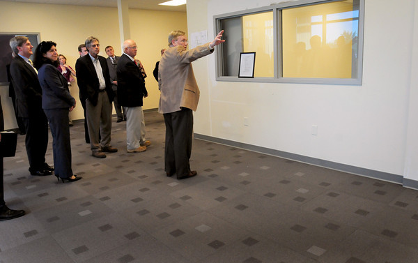 Newburyport: Art Currier shows some of the office space at a new Clean-Tech center in Newburyport's industrial park. The carpets, which are made to break down when they go to a landfill, and have ecology-friendly chemicals. Bryan Eaton/Staff Photo
