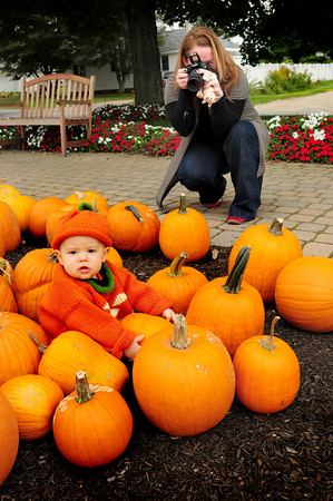 Amesbury: Sawyer Kardos, 11 months, of Amesbury gets his photo taken amongst the pumpkins at Cider Hill Farm, while dressed as a pumpkin, by familly friend Sharon Ferrant of Merrimac. His mother, Nicole, wanted a photo taken to have on hand for his first birthday next month and enlisted Ferrant who is a serious amateur. Bryan Eaton/Staff Photo