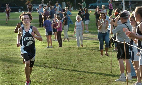 Hamilton: Winner Conor Lyons crosses the finish line. Bryan Eaton/Staff Photo