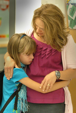 Salisbury: Katelyn Keeler, 7, is a little teary-eyed as she gets a hug from her mother, Jane, as she starts her first day of school in Kelly Clayton's second grade class yesterday at Salisbury Elementary School. Katelyn shouldn't be too lonely, though, as her mother is a kindergarten teacher at the school just around the corner. Bryan Eaton/Staff Photo