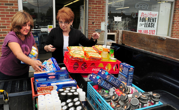 Salisbury: Alpha-Omega Salon owner Linda Boragine, right, and stylist Denise Nalesnik load food destined for the Pettengill House Food Pantry which Boragine arranged for from the closed Richdale Store in Salisbury Square. Bryan Eaton/Staff Photo