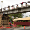 Byfield: The pedestrian walkway at the Governor's Academy in Byfield is being reinforced to support the covered bridge, in the back, that will sit atop the structure. Bryan Eaton/Staff Photo