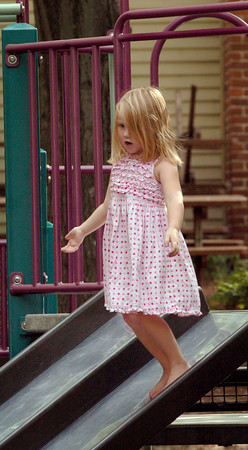 Newburyport: Delaney Woekel, 4, walks down the slide at the Tot Lot on Inn Street in Newburyport yesterday afternoon. She was there with her mom, Jody, and older siblings after they got out of school. Bryan Eaton/Staff Photo