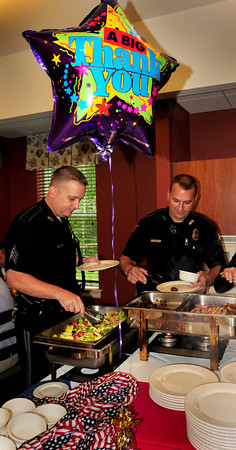 Newburyport: Newburyport Police Sgt. Howard Adams, left, and Officer John Schmidt go through a buffet line at Atria Merrimack Place on Monday afternoon. The facility was holding a Heroes Luncheon to thank Newburyport Police and Fire Departments and American Medical Response for all they do for the city and for the residents there. Bryan Eaton/Staff Photo