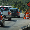Amesbury: Civilian flaggers are directing traffic along the construction on Route 110 in Amesbury just east of Interstate 495. Bryan Eaton/Staff Photo