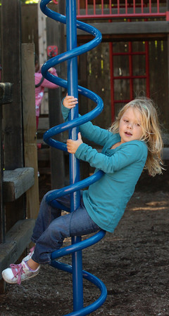 Newburyport: Kindergartner Sophia Wilcox, 5, climbed only halfway up this playground equipment before sliding down the spiral bar, saying she was nervous about going all the way to the top. The Brown School student was at recess with her classmates during Tuesday's nice weather. Bryan Eaton/Staff Photo