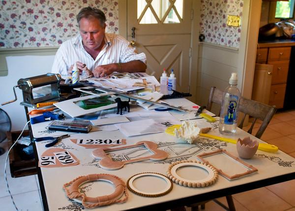Newbury: Artist Michael Updike works in his Newbury kitchen. Bryan Eaton/Staff Photo